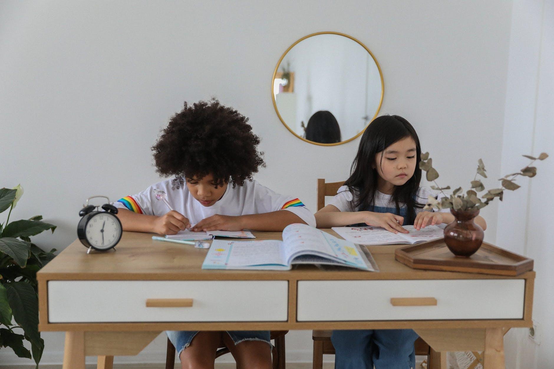 focused multiethnic children doing homework